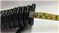 #The standard trailer hitch tow quick disconnect slinky cable is 1/4 in. thick.